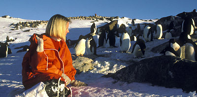 Trish Hart with Adelie penguins at Davis base 1987